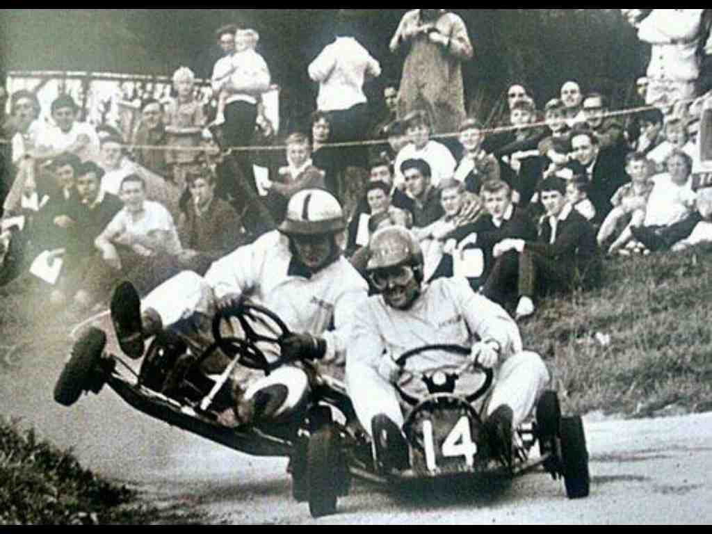 "Here we see Jack Brabham demonstrating his excessively exhuberent racing methods that earned him the nickname ""Black Jack"" to a young Bruce McLaren."
