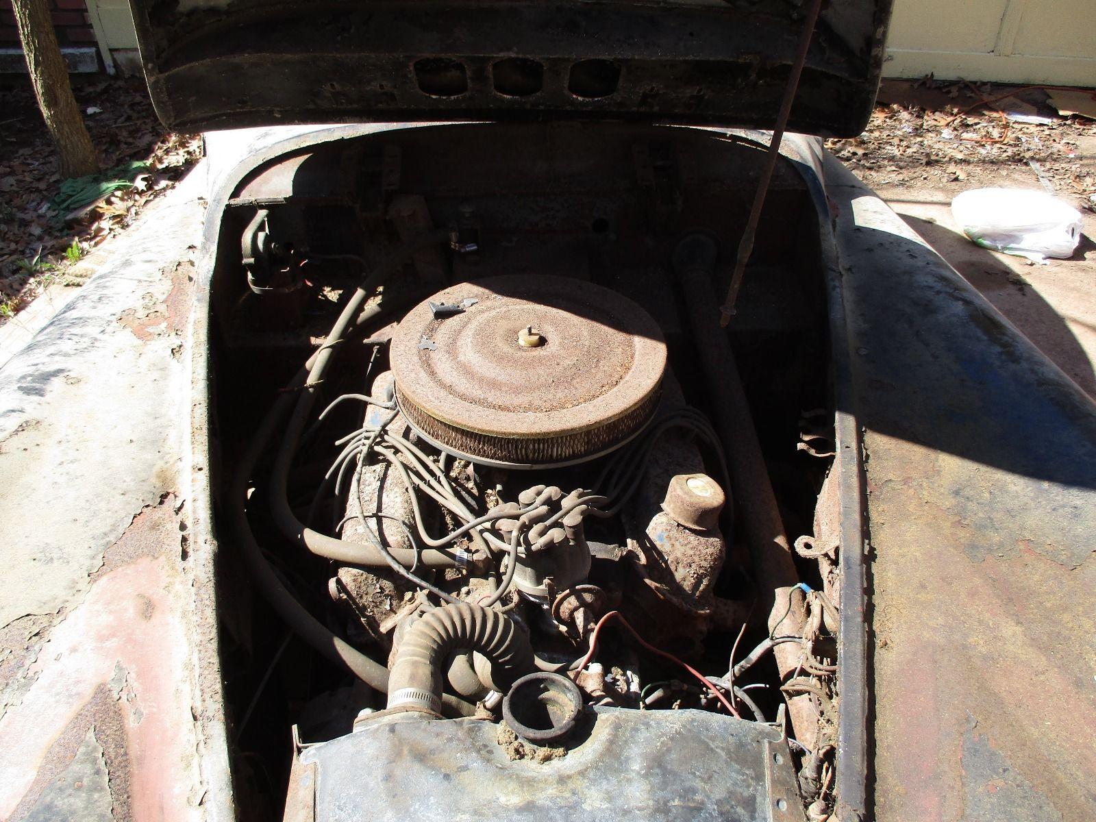 Yes, your beady little eyeballs do not deceive you. A V8 tidily ensconced under that slender Jaguar XK120 hood.