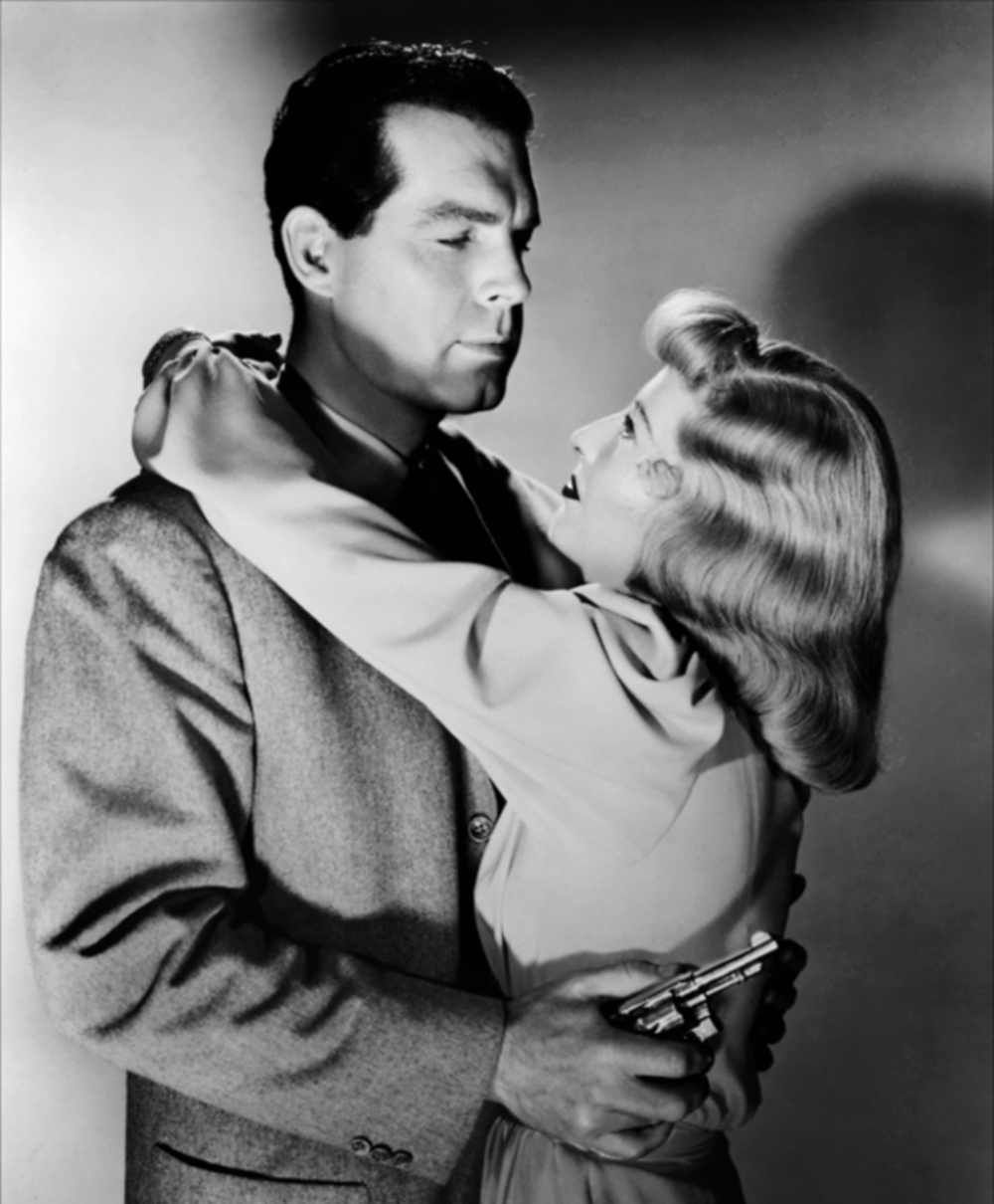 """There are of course three movie stars in this picture, Fred MacMurray, Barbara Stanwyck, and a little Smith & Wesson Model 10. The movie was """"Double Indemnity"""" from 1944. (Picture courtesy range365.com)."""