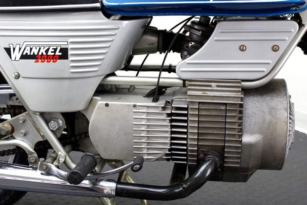 The longitudinally mounted single rotor Wankel engine drives a conventional chain drive though a right angle bevel gear.