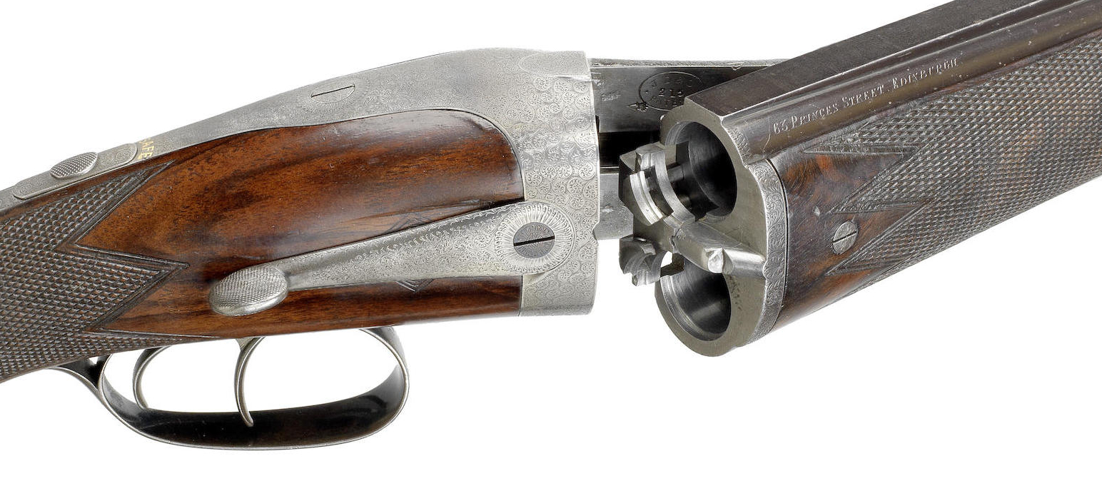 This side opening 12 bore over and under double barreled shotgun by J. Dickson and Son is an extremely rare bird.