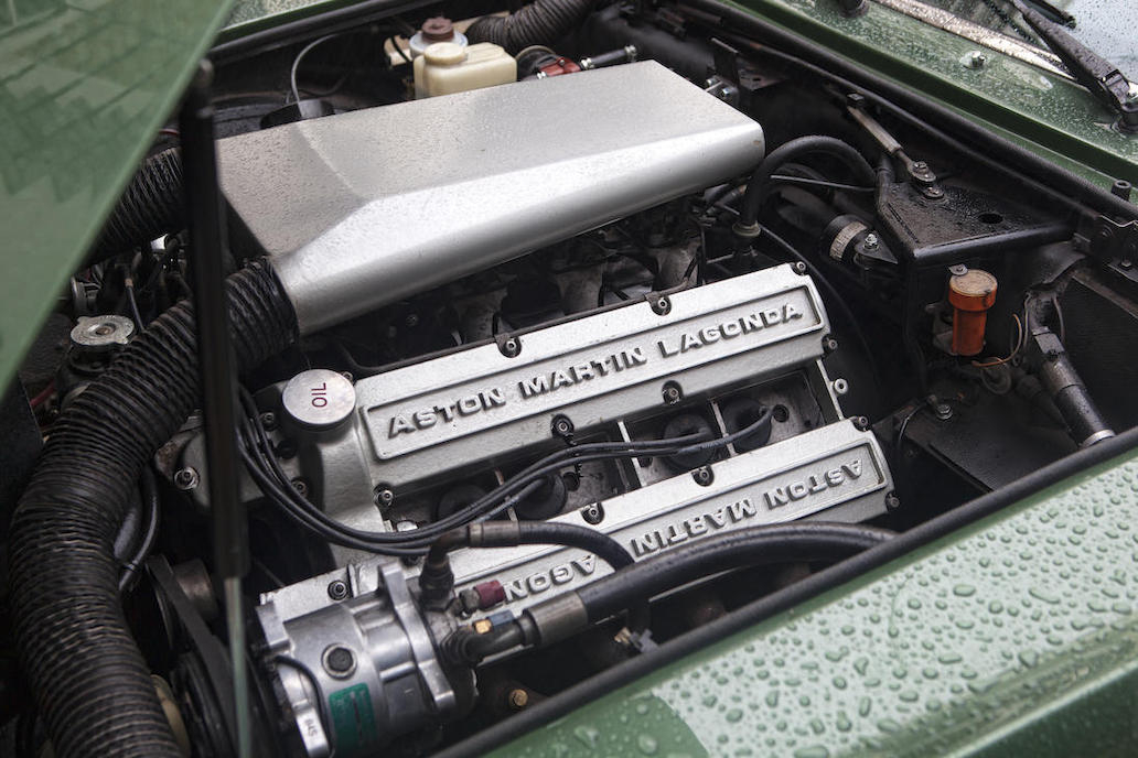 The Aston Martin 5.3litre V8 engine designed by  Tadek Marek is impressive to look at and produced impressive power when not muffled by emissions controls.