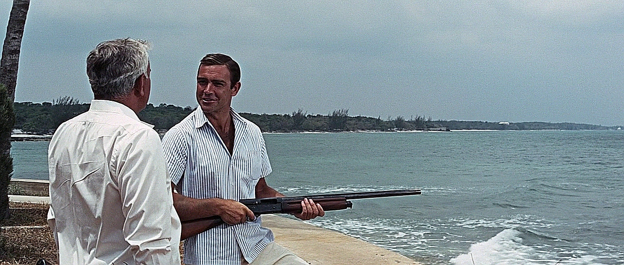 James Bond with Browning Auto 5 in Thunderball. I wonder if 007 is telling Viktor Largo the bronze ring and friction ring need adjusting? (Picture courtesy Internet Movie Firearms Database).
