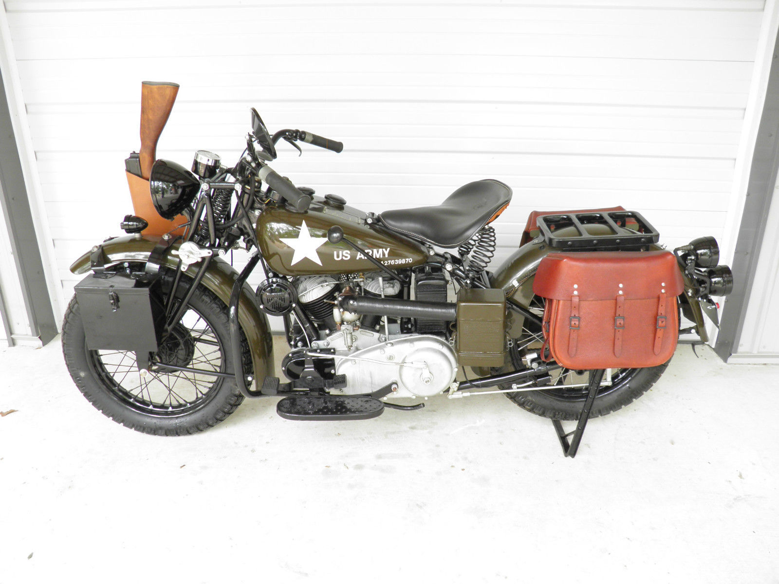 This is the Indian Motocycle 741 for sale on eBay. Note the different placement of the gear lever, the tool box on the left fork, and the carrier located over the center of the rear axle. (Picture courtesy eBay).