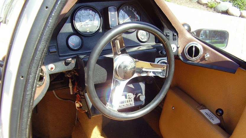 The cockpit of the LItestar is well layed out. The car is much more refined than a Messerschmidt micro car. (Picture courtesy Mecum Auctions).