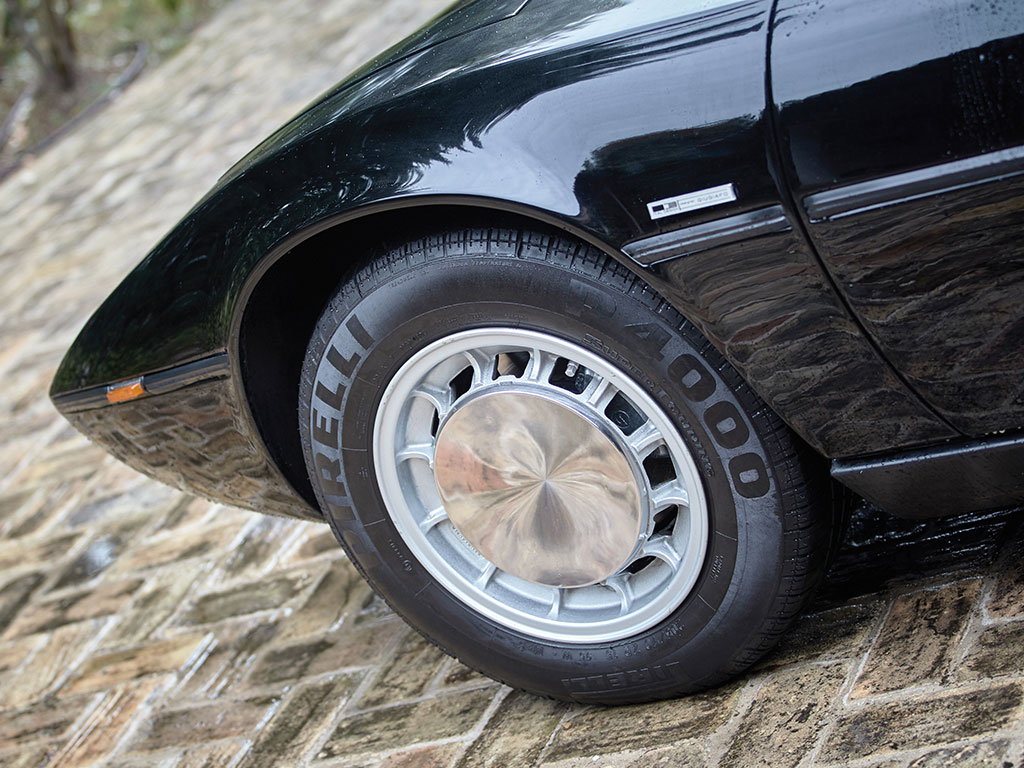 Early model Maserati Bora had stainless steel hubcaps over their Campagnolo alloy wheels.
