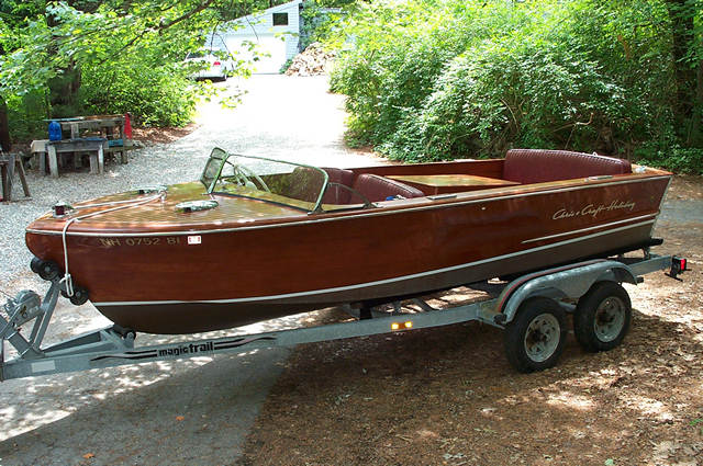 1957 18' Chris Craft Holiday powered by a Chris Craft Model KFL 131 HP twin carb 6 Cyl, West bottom, pleated upholstery, walk through front seat, full cover and tandem trailer with spare. All in excellent cond.