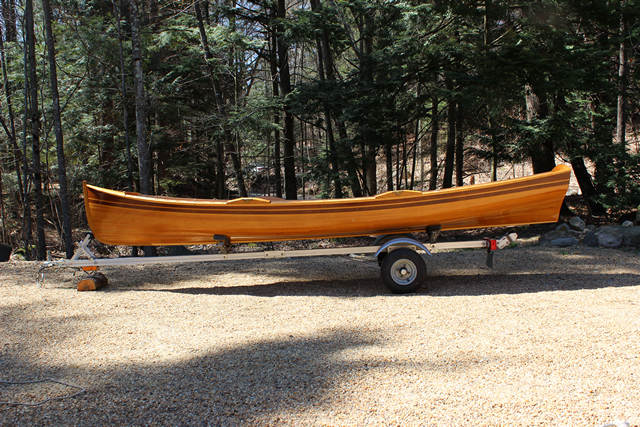 "2003 15'2'' Rangeley Lake Boat built by Newfound Woodworks includes a pair of 8' curved blade oars with leather sleeves and stops, oar locks and trailer. Beam 46"", weight 100 lbs, draft 6.5"", displacement 675 and capacity 531 lbs. Constructed with Northern White Cedar, Mahogany, Sapele, Spanish Cedar and Spruce. Elegant boat in excellent condition always stored inside."