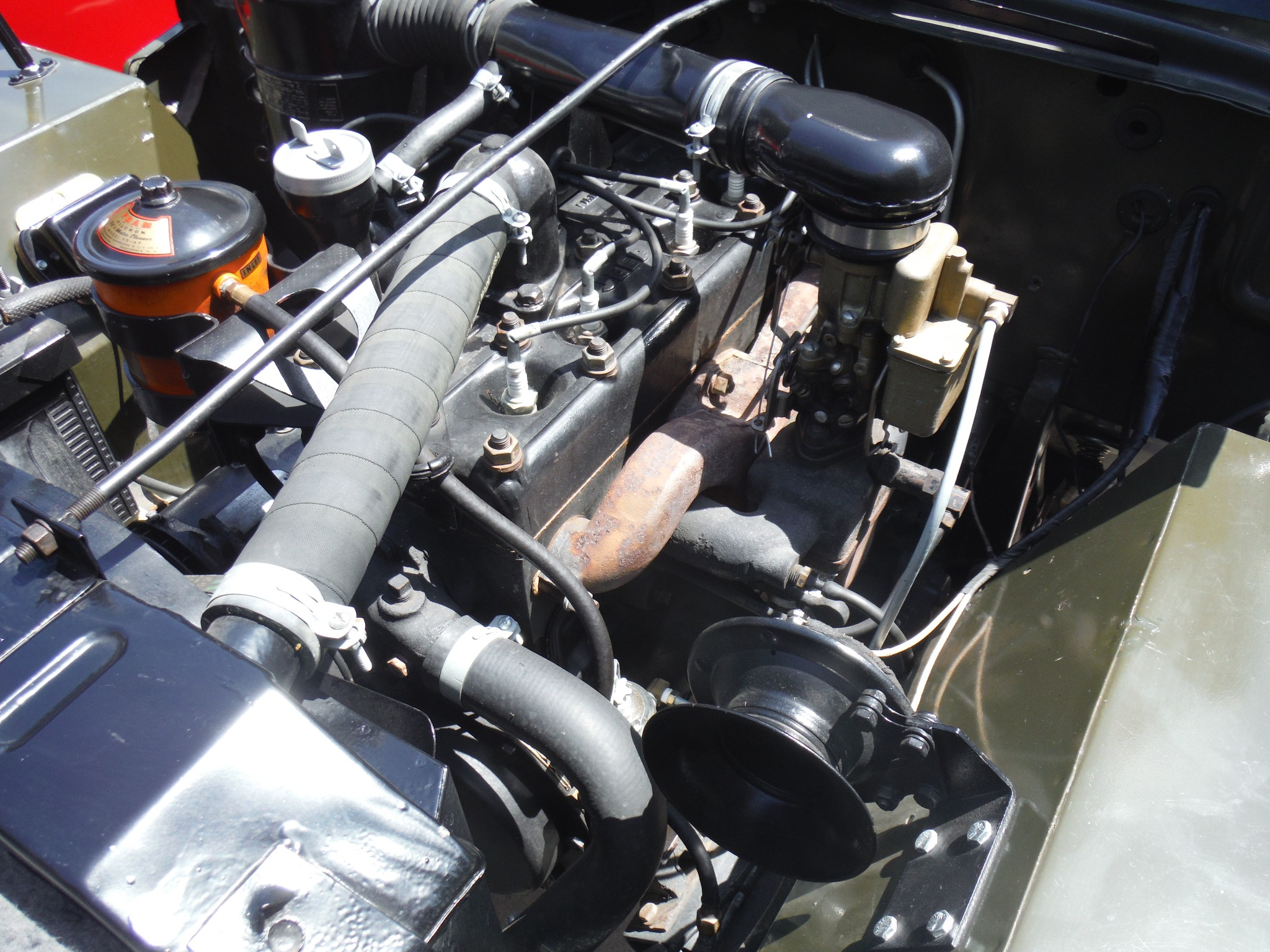 The engine is the familiar World War II four cylinder flat head side valve unit producing 60hp.