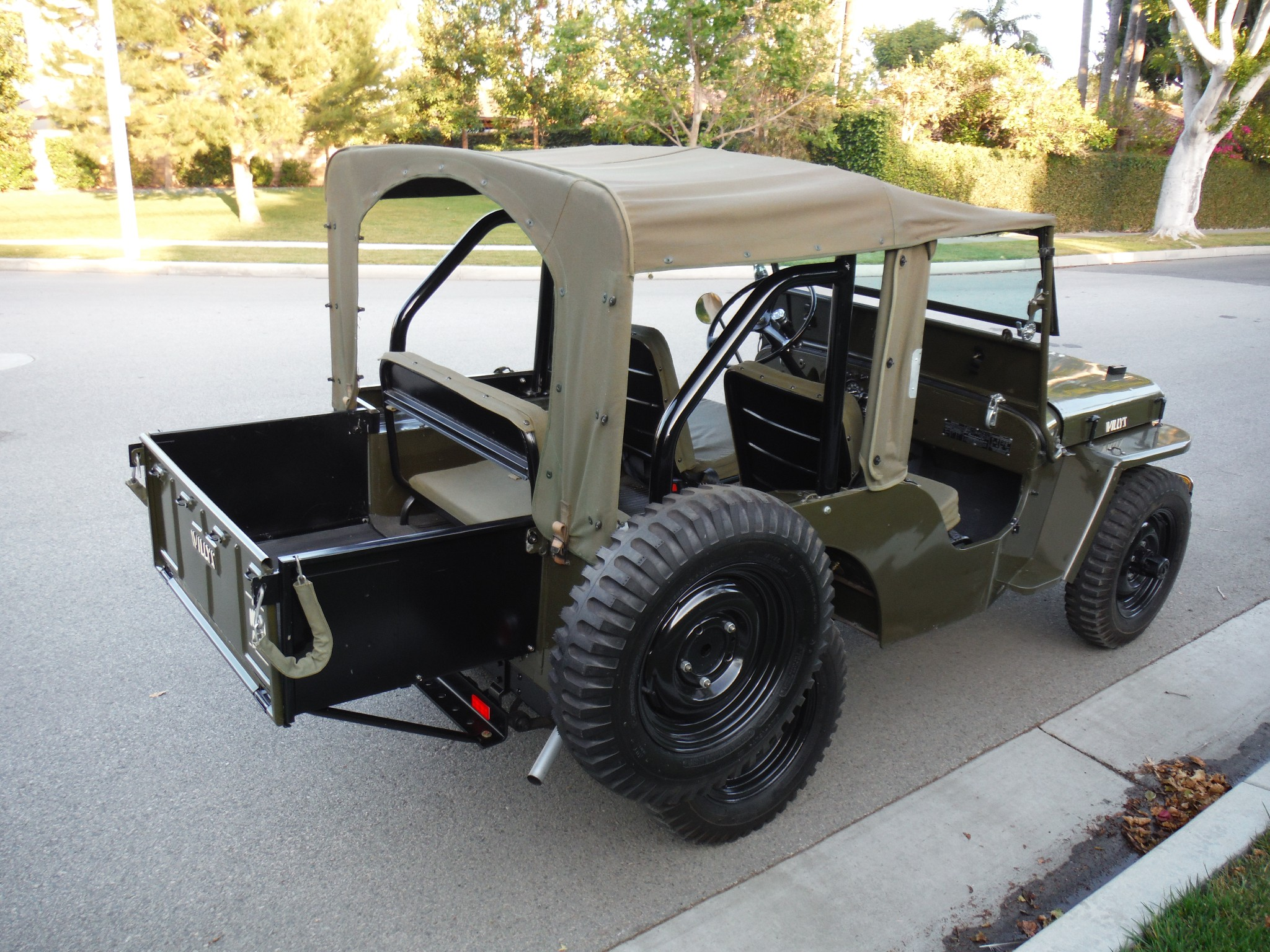 This 1947 Willys Jeep CJ2A has an attachable tray that adds pick-up style carrying capacity.
