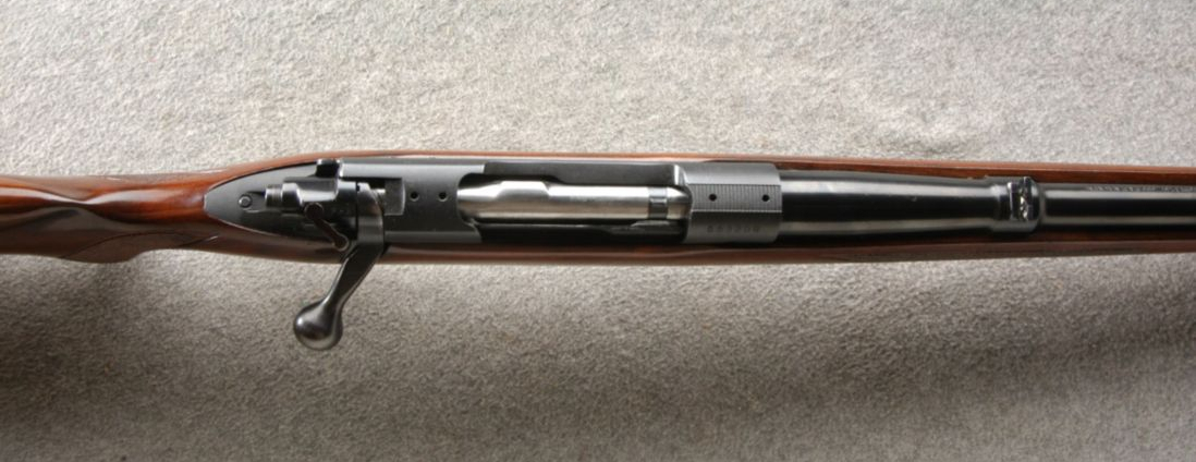 Seen from the top this Pre 64 Model 70 in .300H&H the full length Mauser style non-rotating claw extractor is visible. Note that for the long .300H&H and .375H&H the receiver ring and bridge are opened up to facilitate the longer than standard cartridges. (Picture courtesy Cabela's).