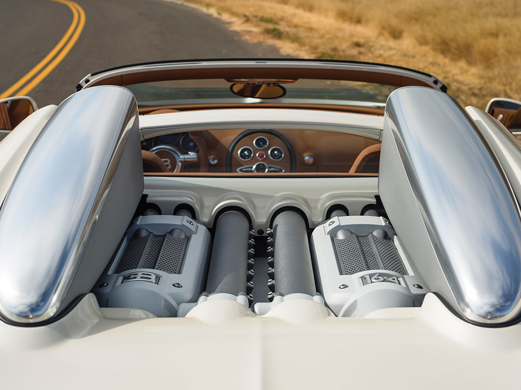 Looking like something you'd expect to see in a Star Wars movie the thousand horsepower engine of the Bugatti Veyron doesn't look like the smelly, oily engine you'd expect to find in a sports car. It looks Space Age. (Picture courtesy RM Sotheby's).