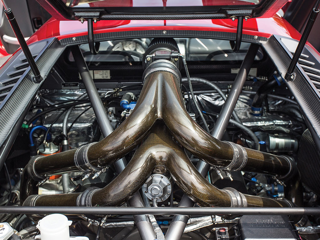 The twin 5.5psi Garret turbochargers feed directly into the carbon fiber exhaust and catalytic converters - no mufflers are used.