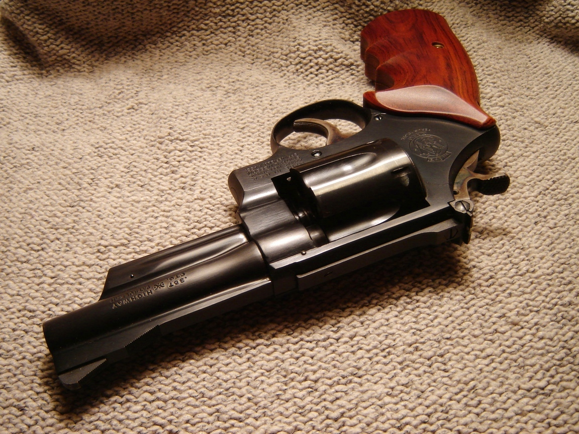 The cheaper and more utilitarian model of the Smith & Wesson Model 27 was the Model 28 Highway Patrolman. These revolvers did not have the checkered top strap of the standard Model 27 and were finished in a lower level of polish. (Picture courtesy lonelymachines.org).