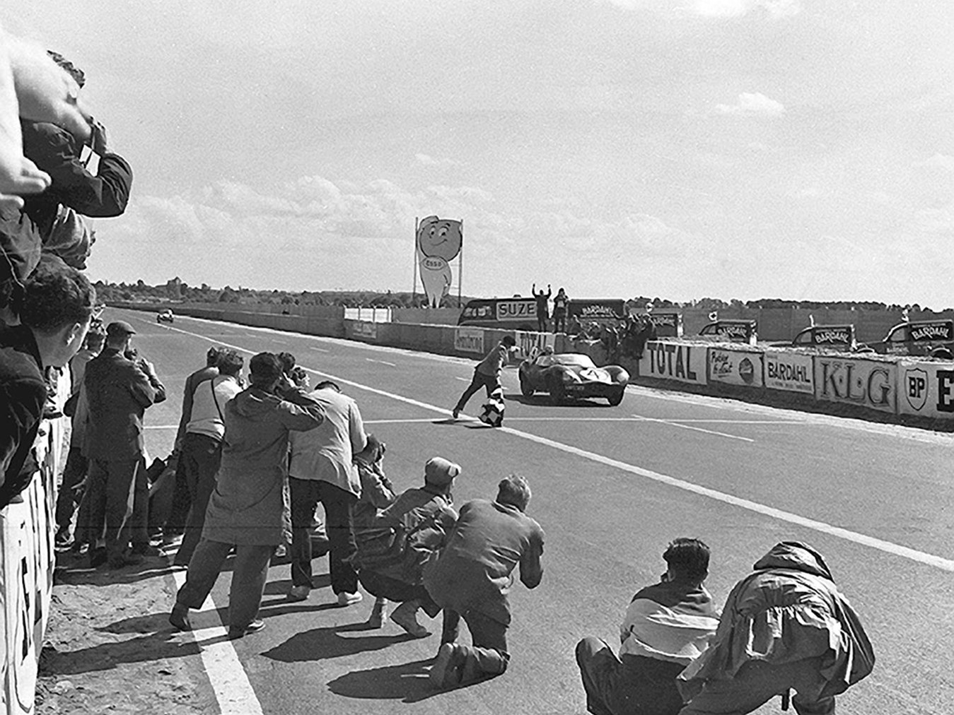 XKD 501 takes the checkered flag winning the 1956 Le Mans. (Picture courtesy the Klemantaski Collection).