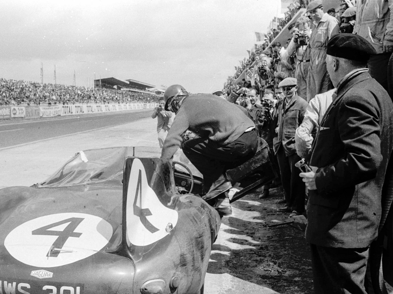 Ninian Sanderson jumps into XKD 501 during the 1956 Le Mans. (Picture courtesy LAT Photographic).