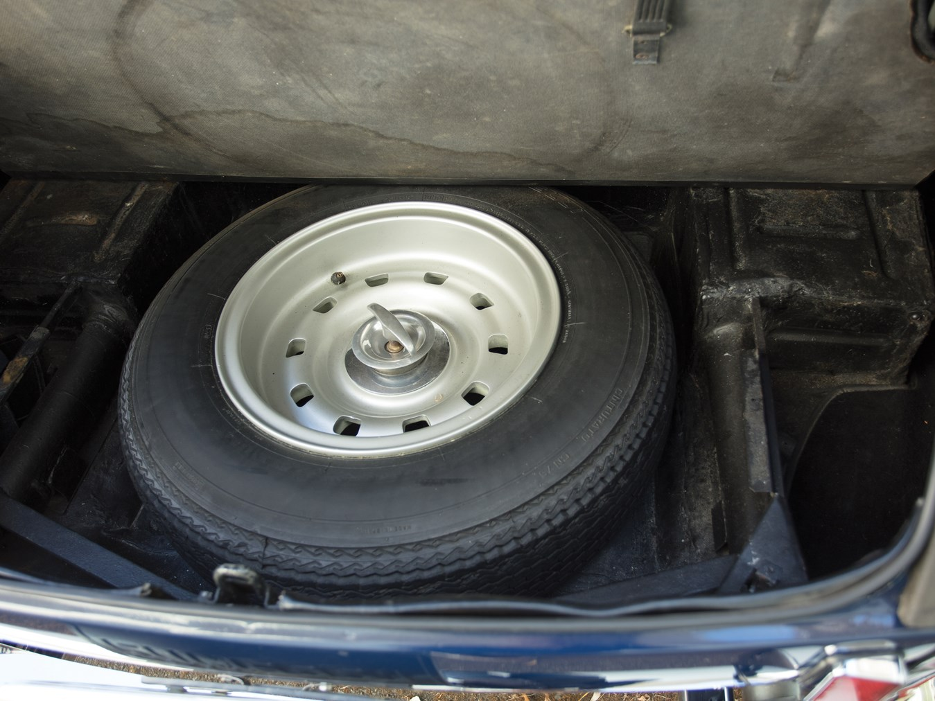 The spare tire sits neatly in a compartment under the luggage space.