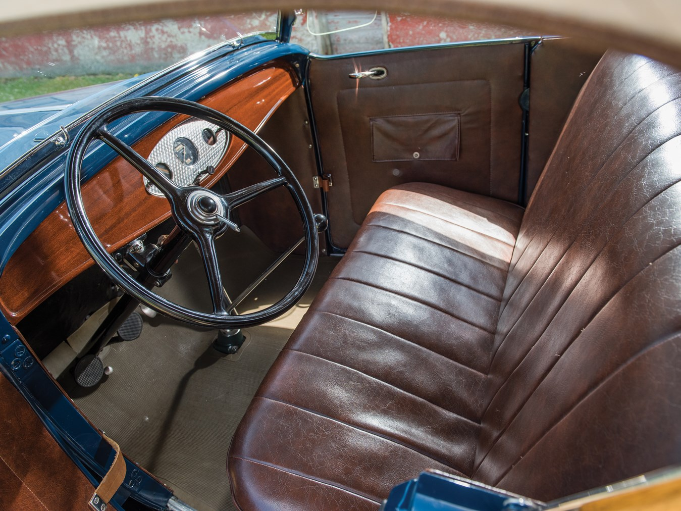 The driver's seat of your very own V8 Ford - the place so many of Henry Ford's customers wanted to be.