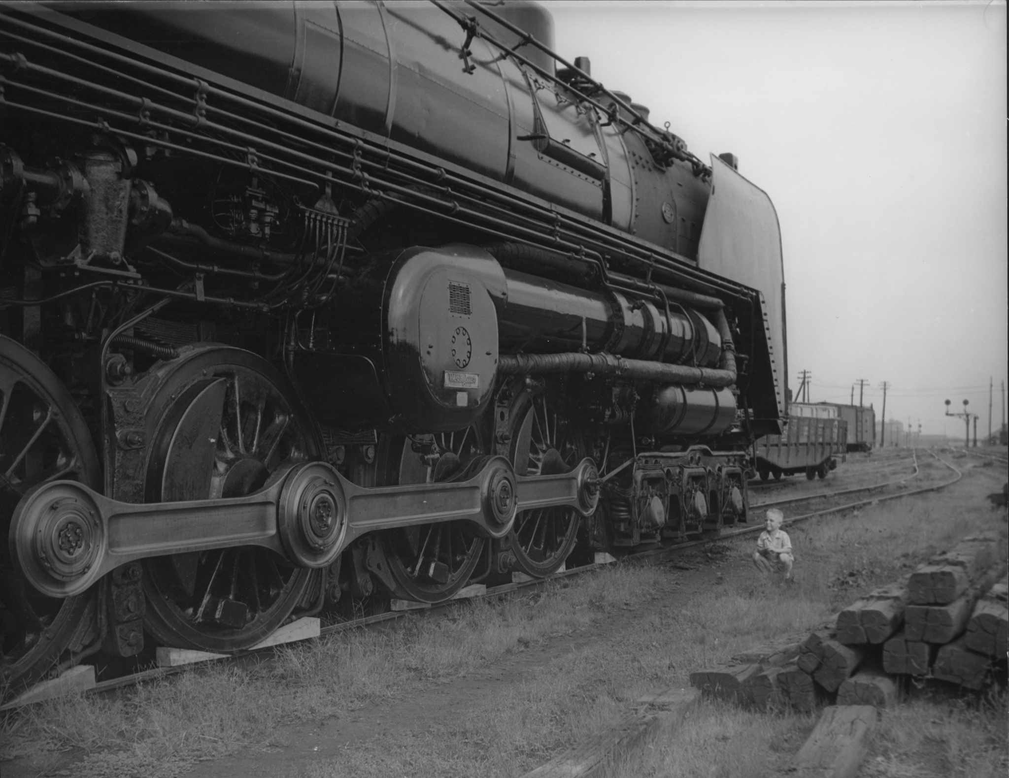 The little boy to the right of this picture knows that this 450 ton Pennsylvania Railroad S2 steam turbine locomotive is going to be the ultimate fun machine to drive on planet earth. (Picture courtesy fiveprime.org).