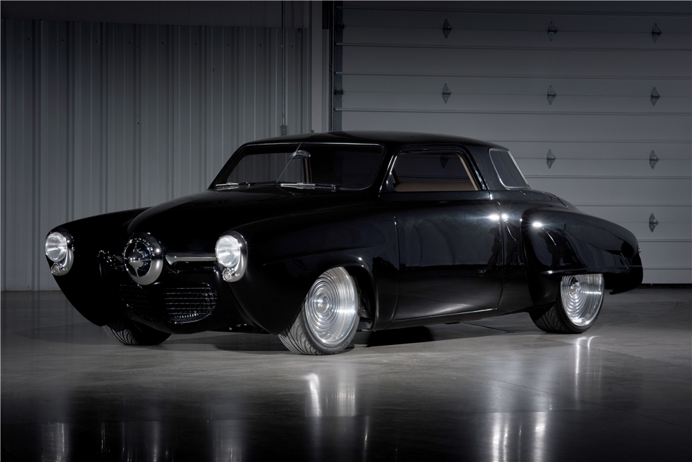 "Custom motorcycle maker Tony Carlini branched out to do a couple of custom cars. His Studebaker Starlight based ""Black Bart"" is a superb example of his work. (Picture courtesy Barrett-Jackson)."
