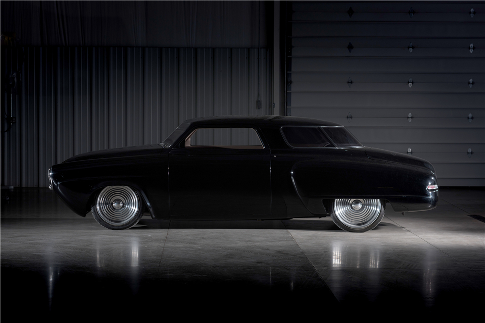 "The Studebaker Starlight's aerodynamics and that ability to look fast even when standing still make ""Black Bart"" an unconventional looking custom car. (Picture courtesy Barrett-Jackson)."