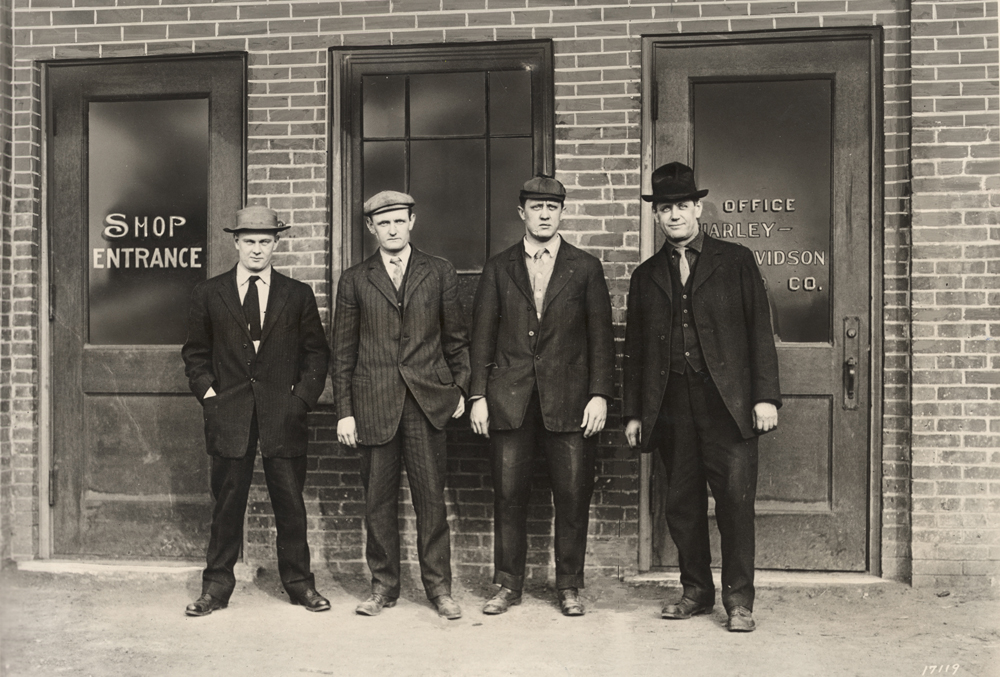 The four founders of the Harley-Davidson Motorcycle Company standing outside the second factory which was rather larger than the original 15'x10' shed. From left Arthur Davidson, Walter Davidson, William Harley, and William Davidson. (Photo courtesy the HD Archives).