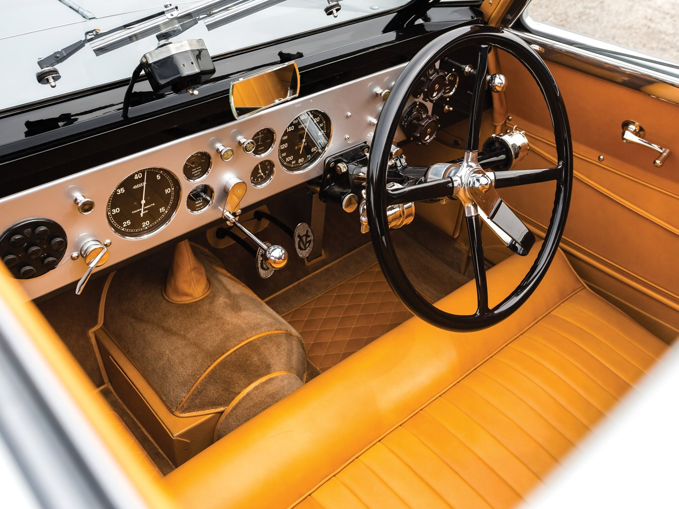 Voisin's blending of aluminium, steel and leather with colour coordinated carpet is masterful.