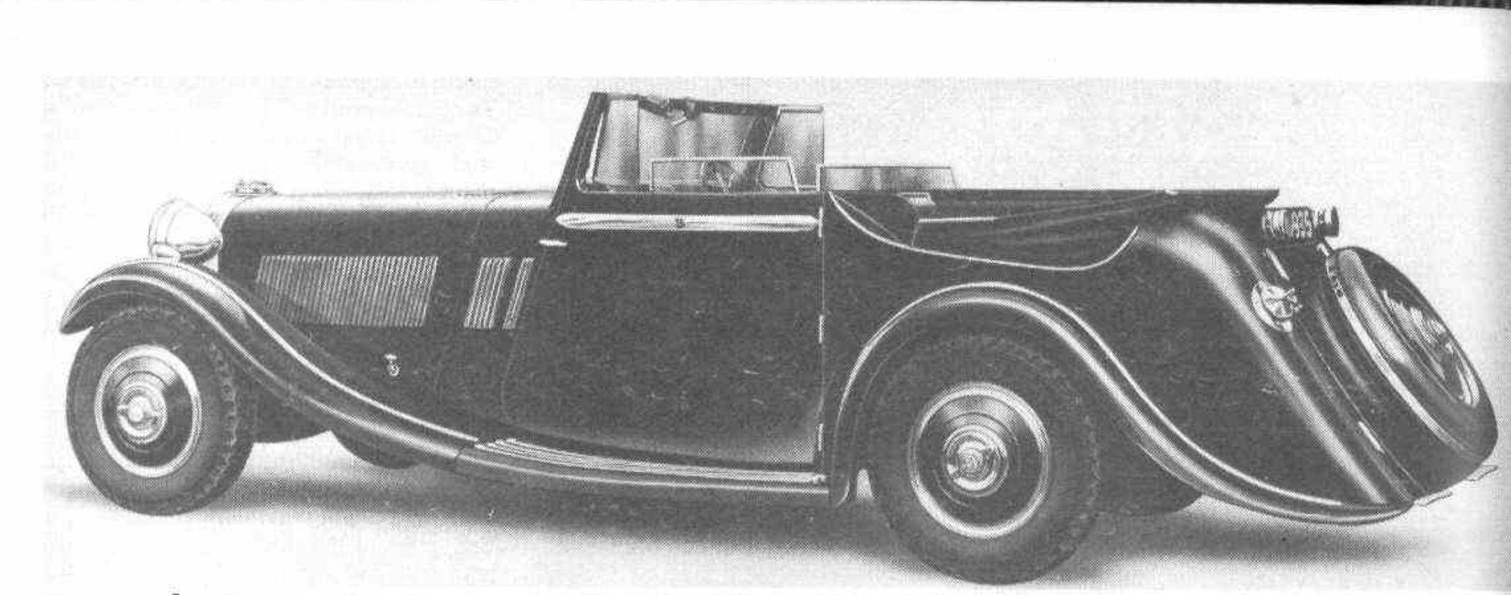 1936 picture of the drophead coupé Brough Superior 4.2 liter eight. The cover folds down flush with the body line. (Picture courtesy motorsportmagazine.com).