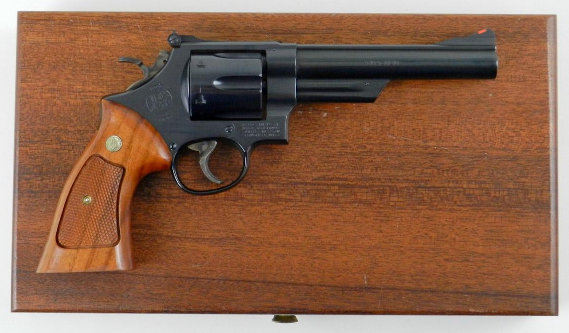The Smith & Wesson Model 57 .41 Remington Magnum revolver complete with mahogany fitted box lined with blue velvet. Expensive and highly desirable. (Picture courtesy icollector.com).