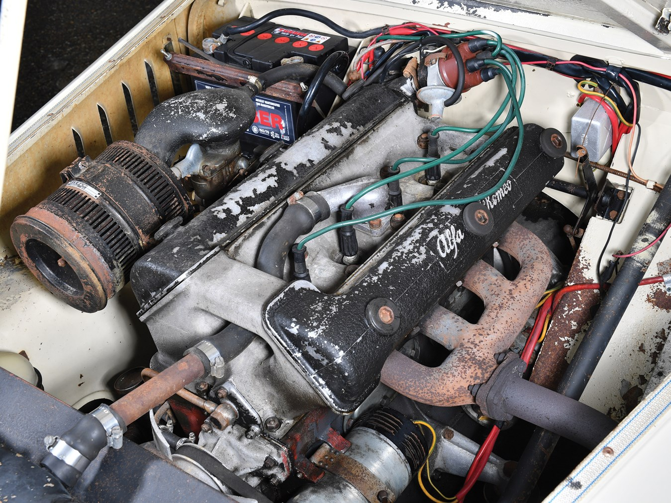 The sight of a DOHC Alfa Romeo engine is not exactly what one expects to see upon opening the hood of a utilitarian 4WD.