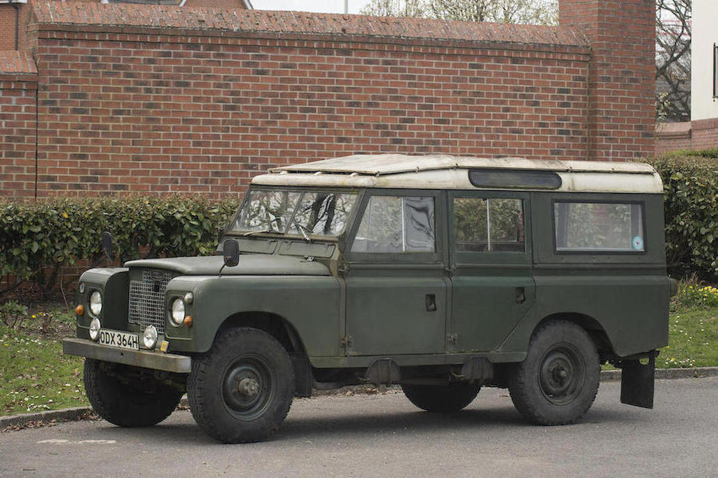 The sale Series IIA Safari station wagon has a Tropical Roof and steps for each passenger door.
