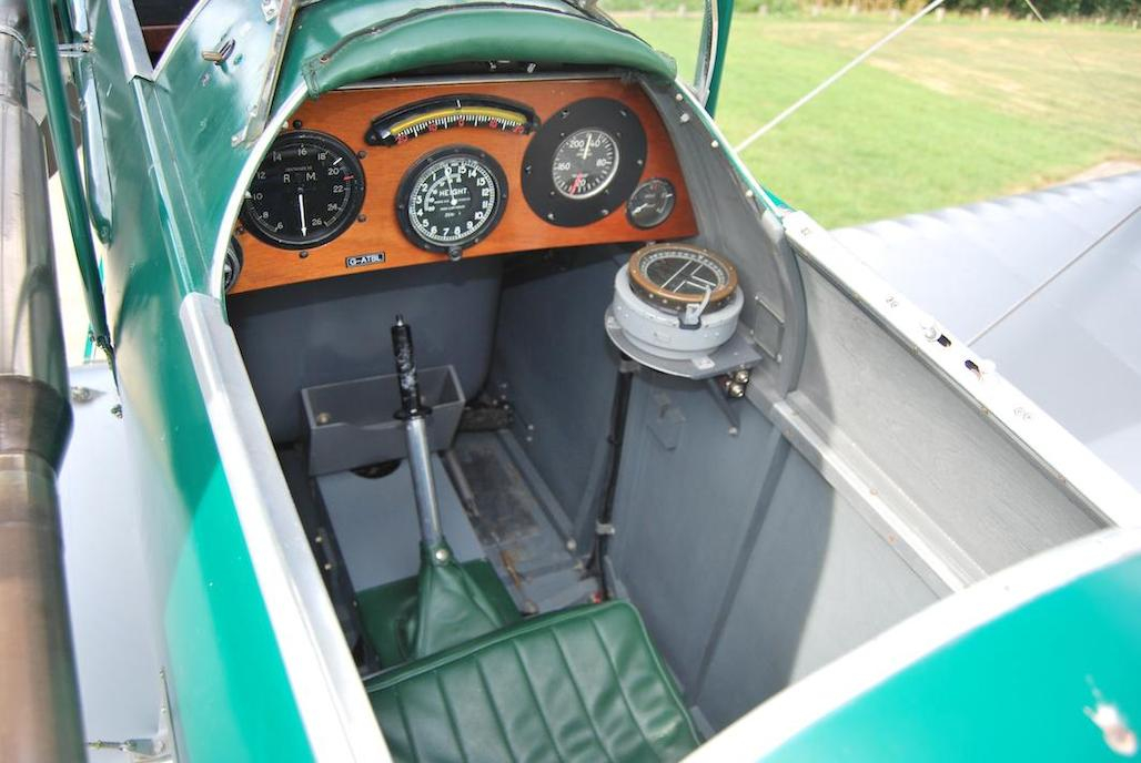 """An open sports car gives a """"wind in the hair"""" experience. A Gipsy Moth provides a """"wind in the hair"""" experience at altitude."""