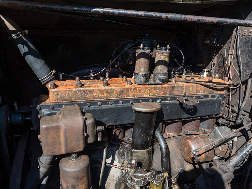The beautiful straight eight Packard engine is in working order and will restore nicely.