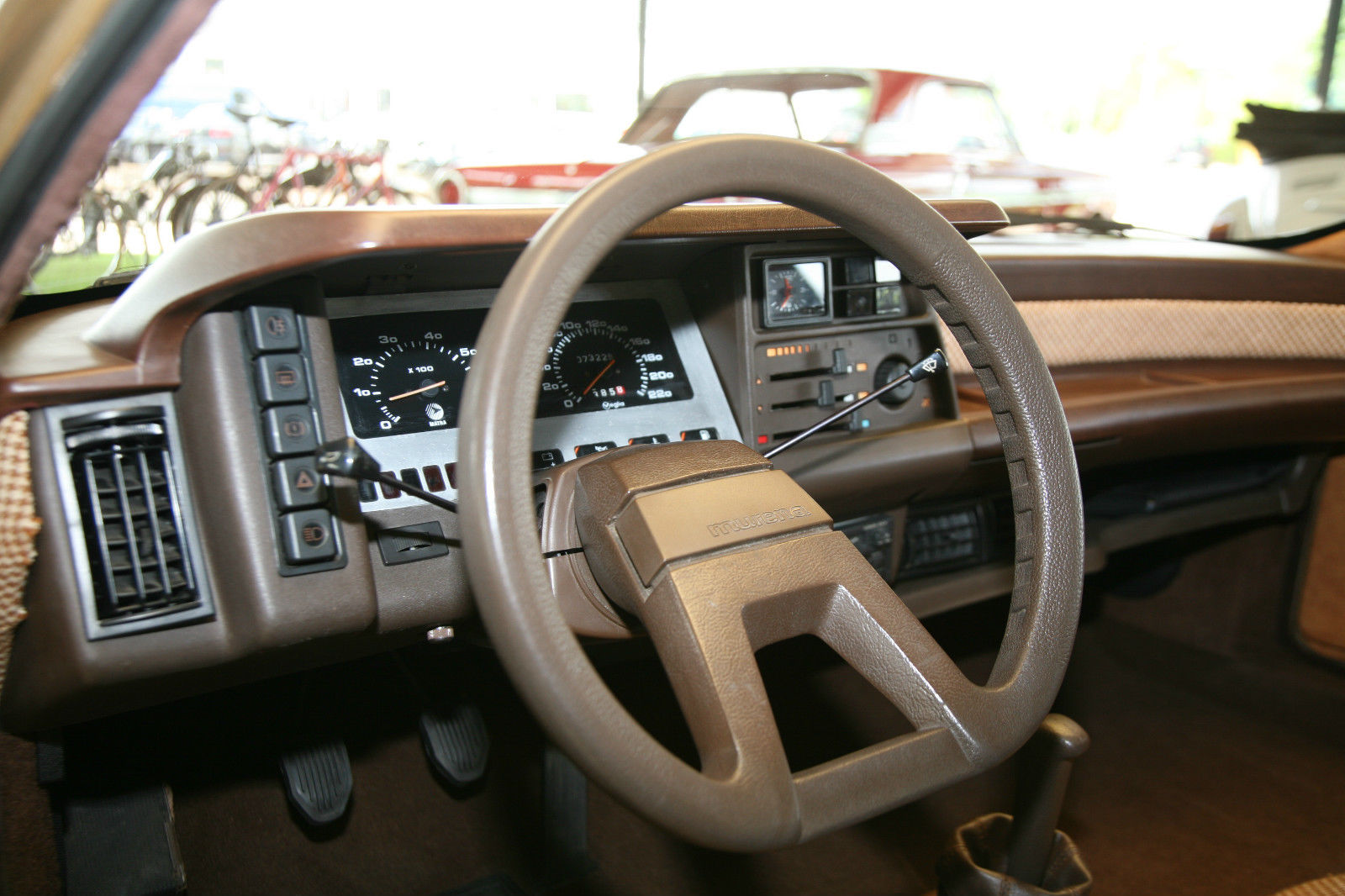 The almost Citroën style steering wheel keeps the driver's view of the instrument panel unobstructed whilst adding to the unusual look of the interior.