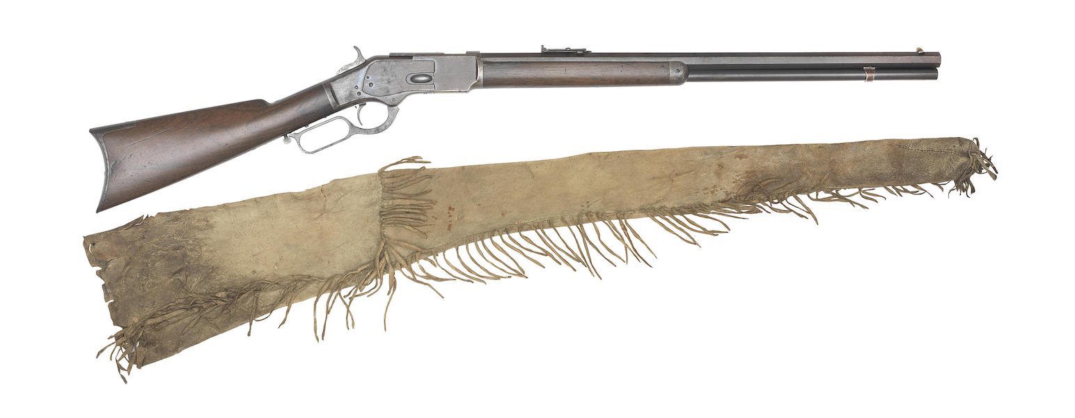 The rifle comes with a native American Indian buff leather slip stitched together and with fringed borders.