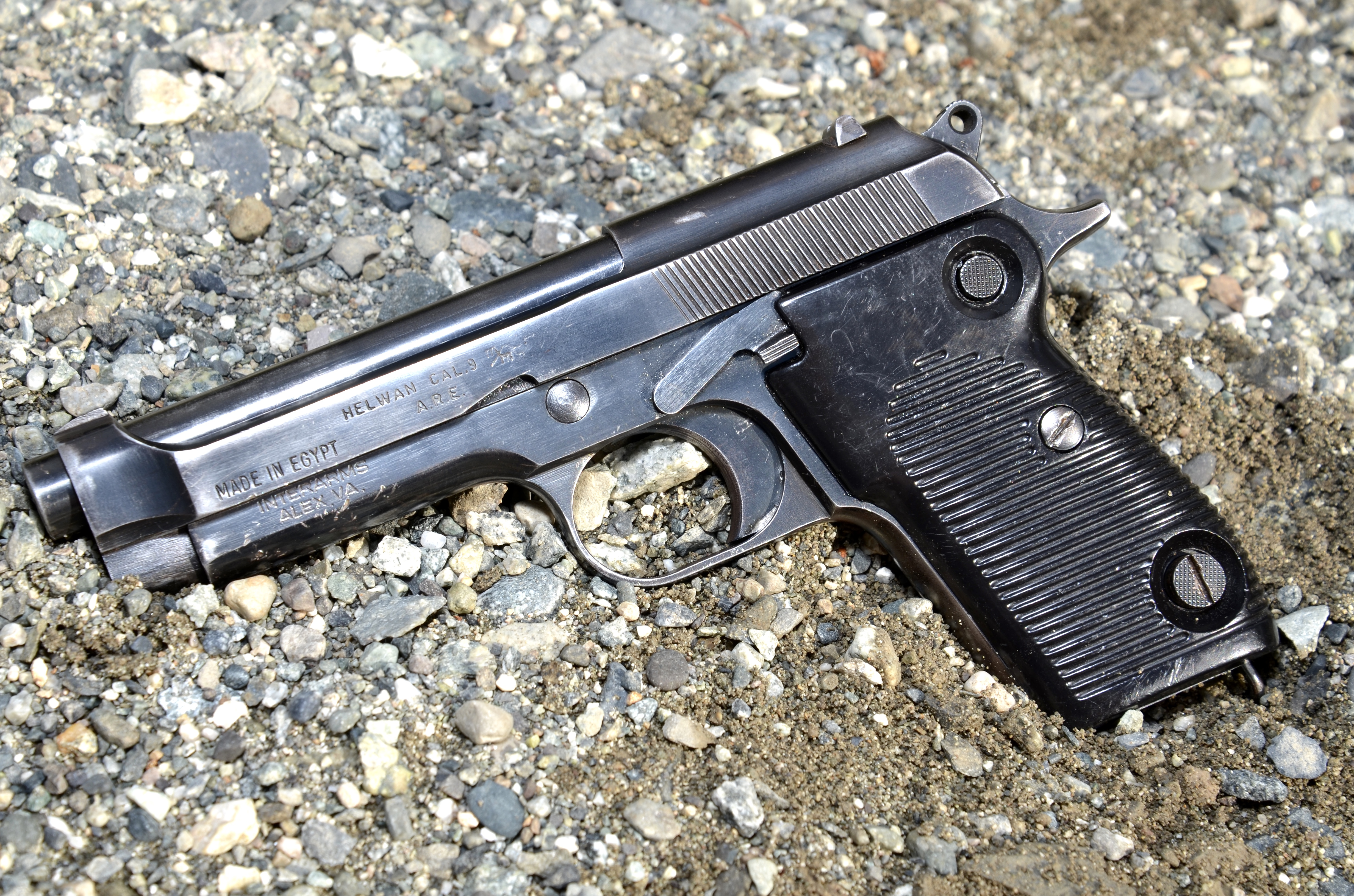 The Egyptian Helwan copy of the Beretta M1951 has some differences from the Beretta version such as the magazine release. (Picture courtesy thearmsguide.com).