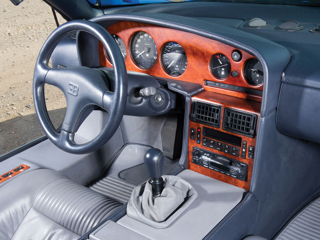 The cockpit of the Bugatti EB110GT is elegant and ergonomic.