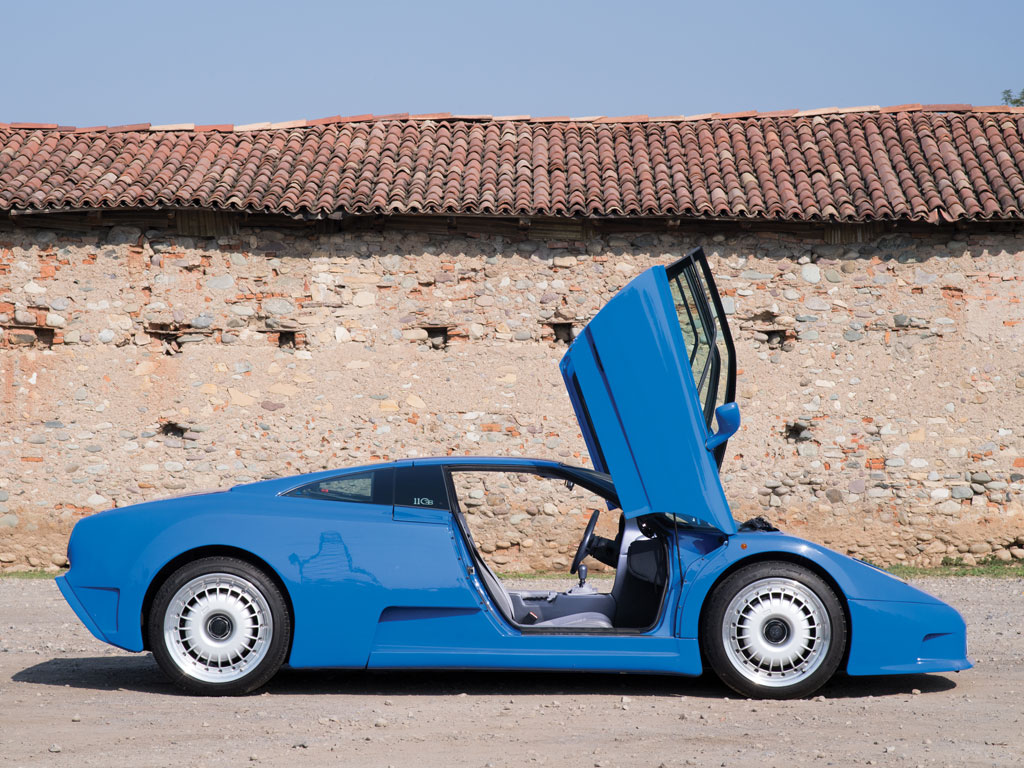 Marcello Gandini's part in the design of the EB110 GT is evidenced in the use of his trademark scissor doors.