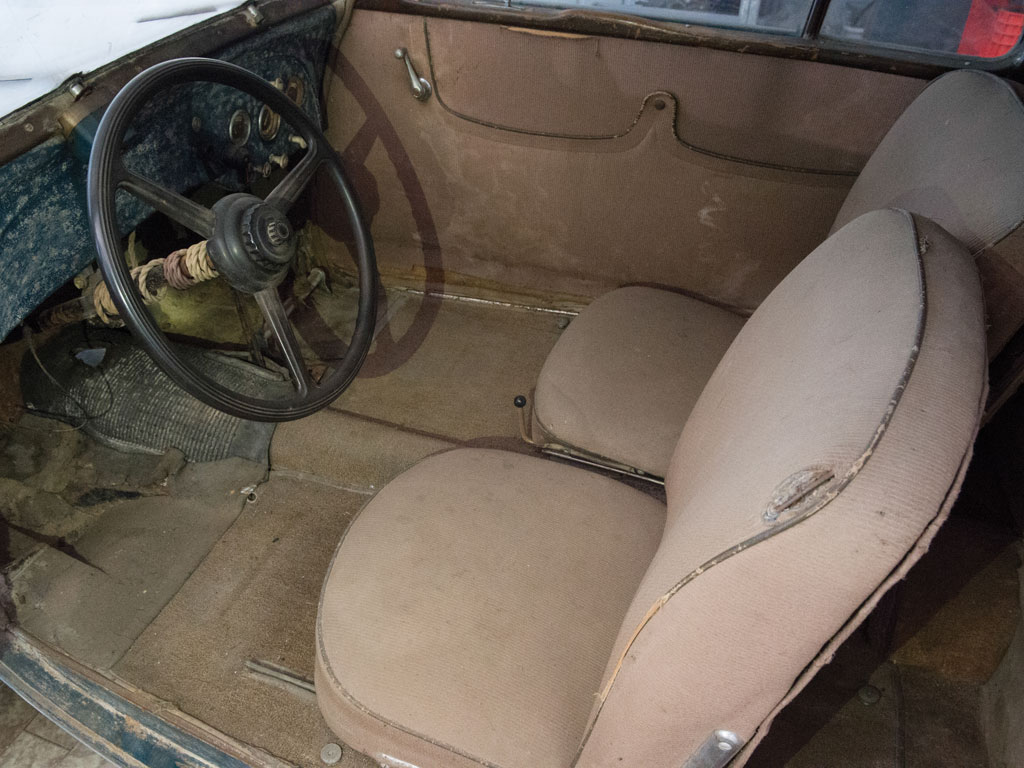 The interior of the barn find car looks to be original although the nautical looking rope around the steering column is not. (Picture courtesy RM Sotheby's).