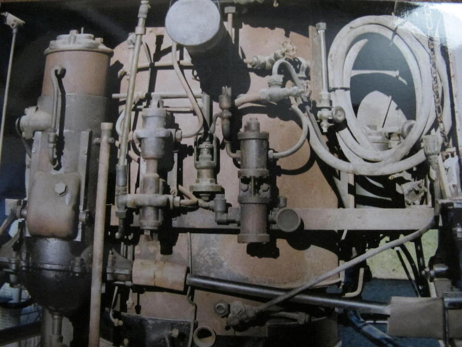 The boiler and engine of the 1897 Hart steam car before restoration.