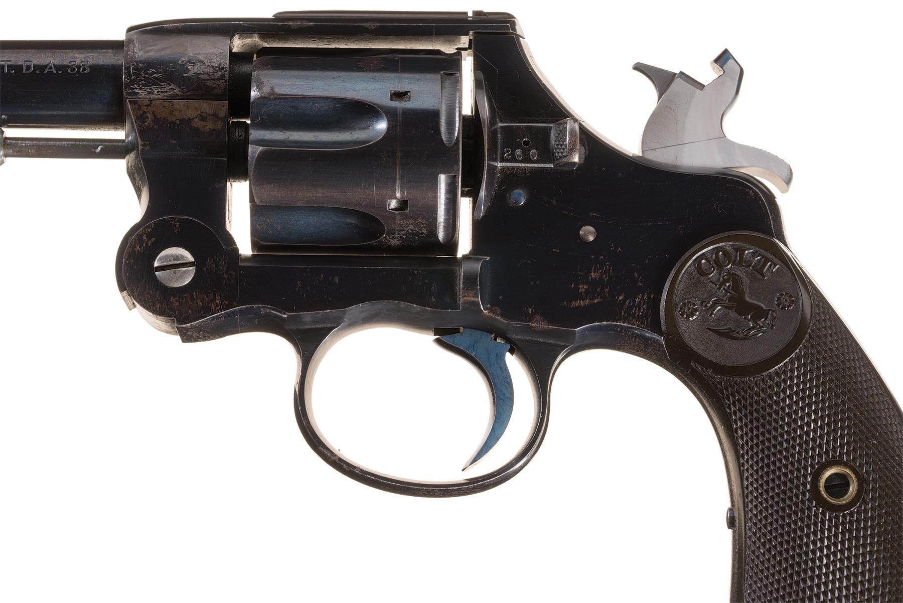 This close up of the action of the Colt top break revolver shows the notched hammer which helps lock the revolver closed.
