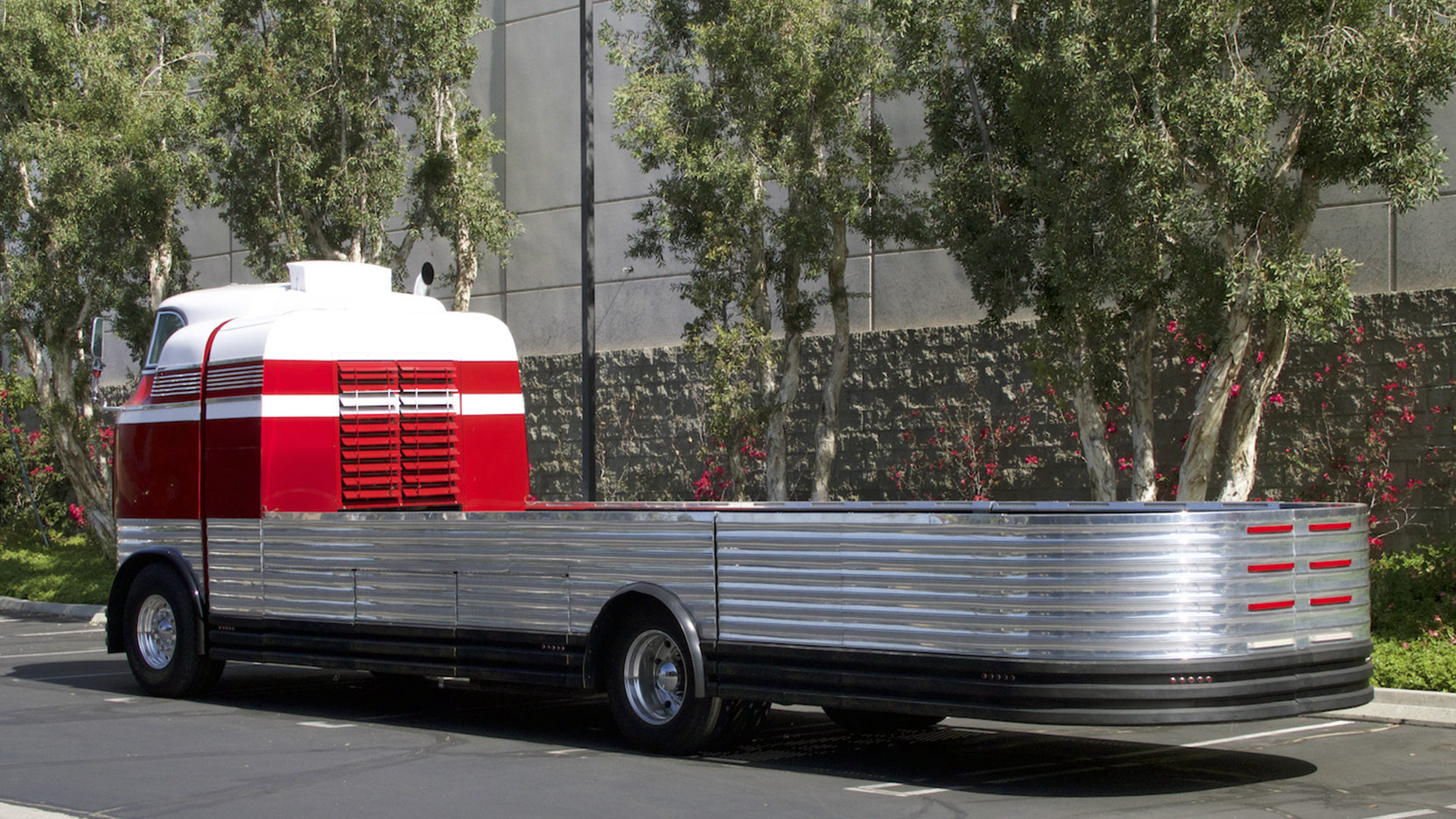 This modified Futurliner features a clamshell rear and 29 foot flat bed space.