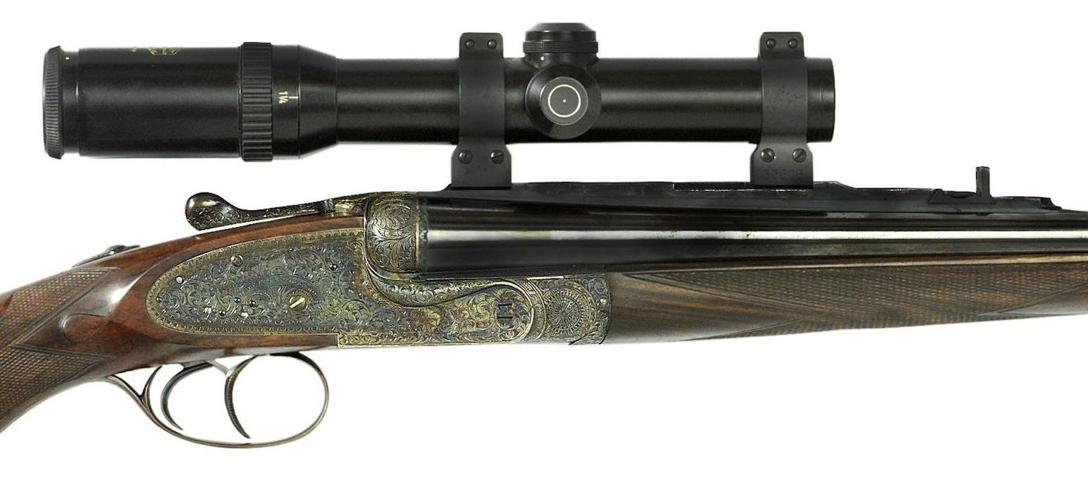 This exquisite Holland & Holland Royal double rifle is fitted with a Schmidt & Bender 1¼-4x24mm rifle-scope in American Talley Quick Detachable mounts.