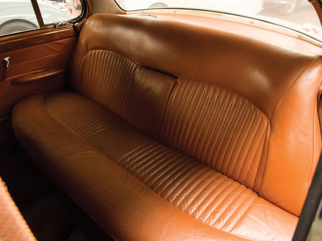 The rear seat of the Jaguar 420G cigar lounge.