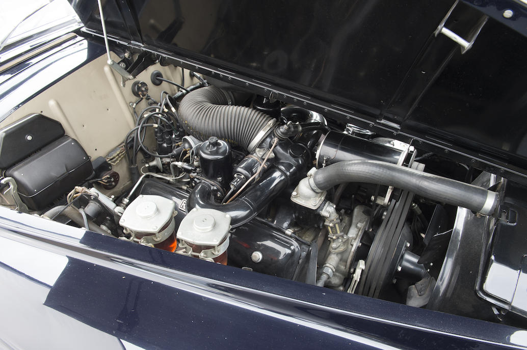 The 6.2 liter Rolls Royce V8 engine breathes through twin SU carburettors.