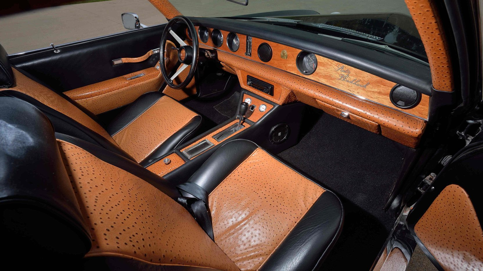 The interior of the revived Stutz is sixties modern with heavy use of leather and wood. It is a luxurious and tasteful design.