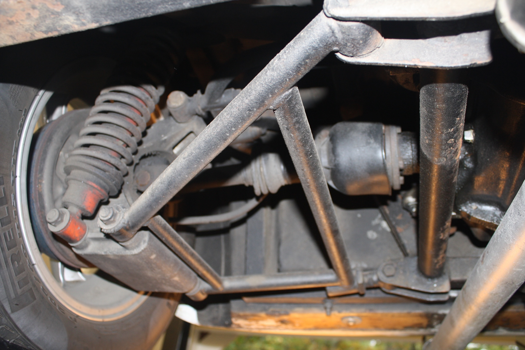 The rear suspension has been kept owner repairable and uses mostly stock Triumph parts.