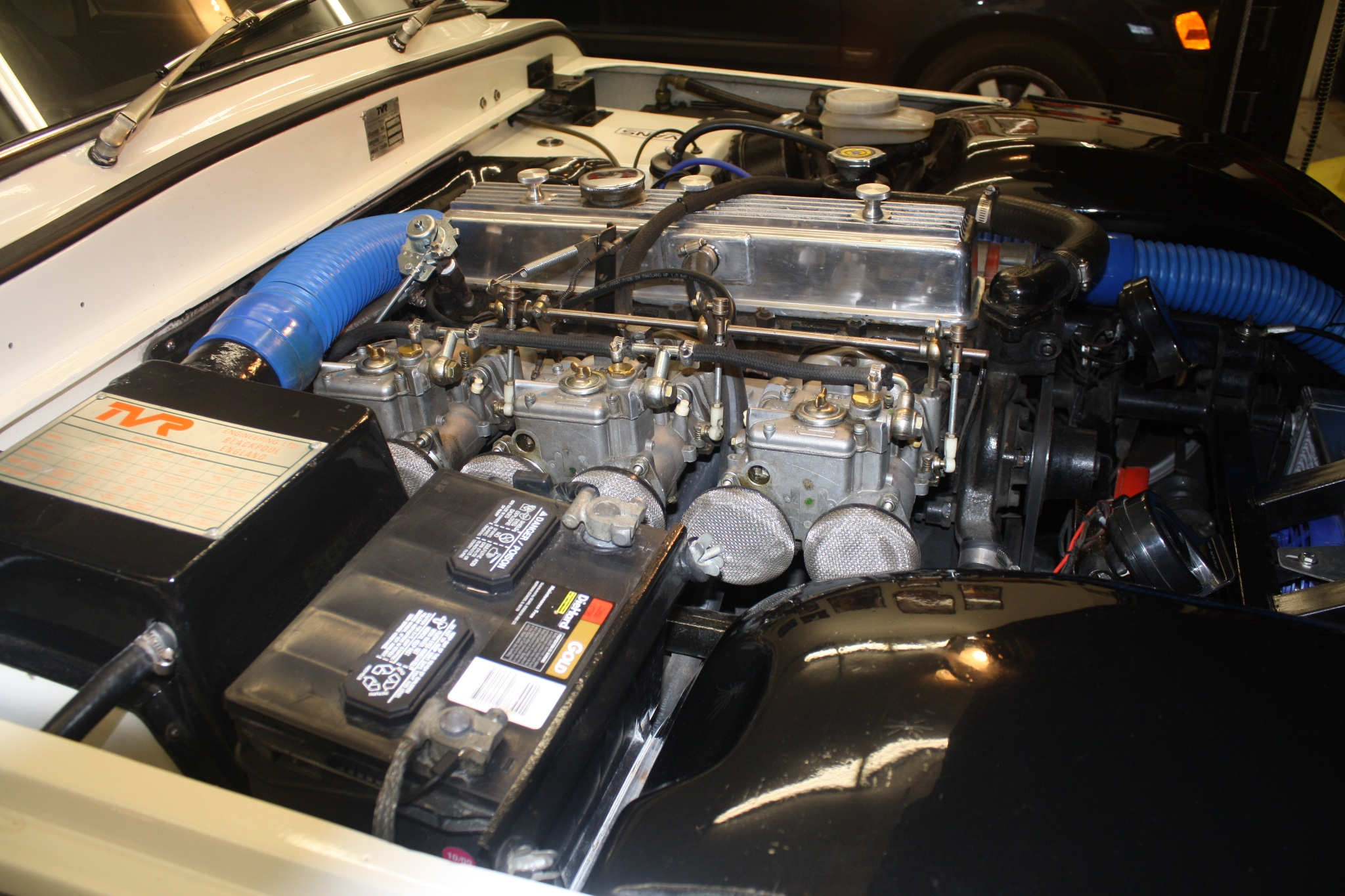 Under the hood of this 1974 TVR 2500M sits a Triumph TR6 2.5 liter six cylinder engine breathing through triple side-draft Webber carburettors. This is a nice amount of power for this lightweight sports car.