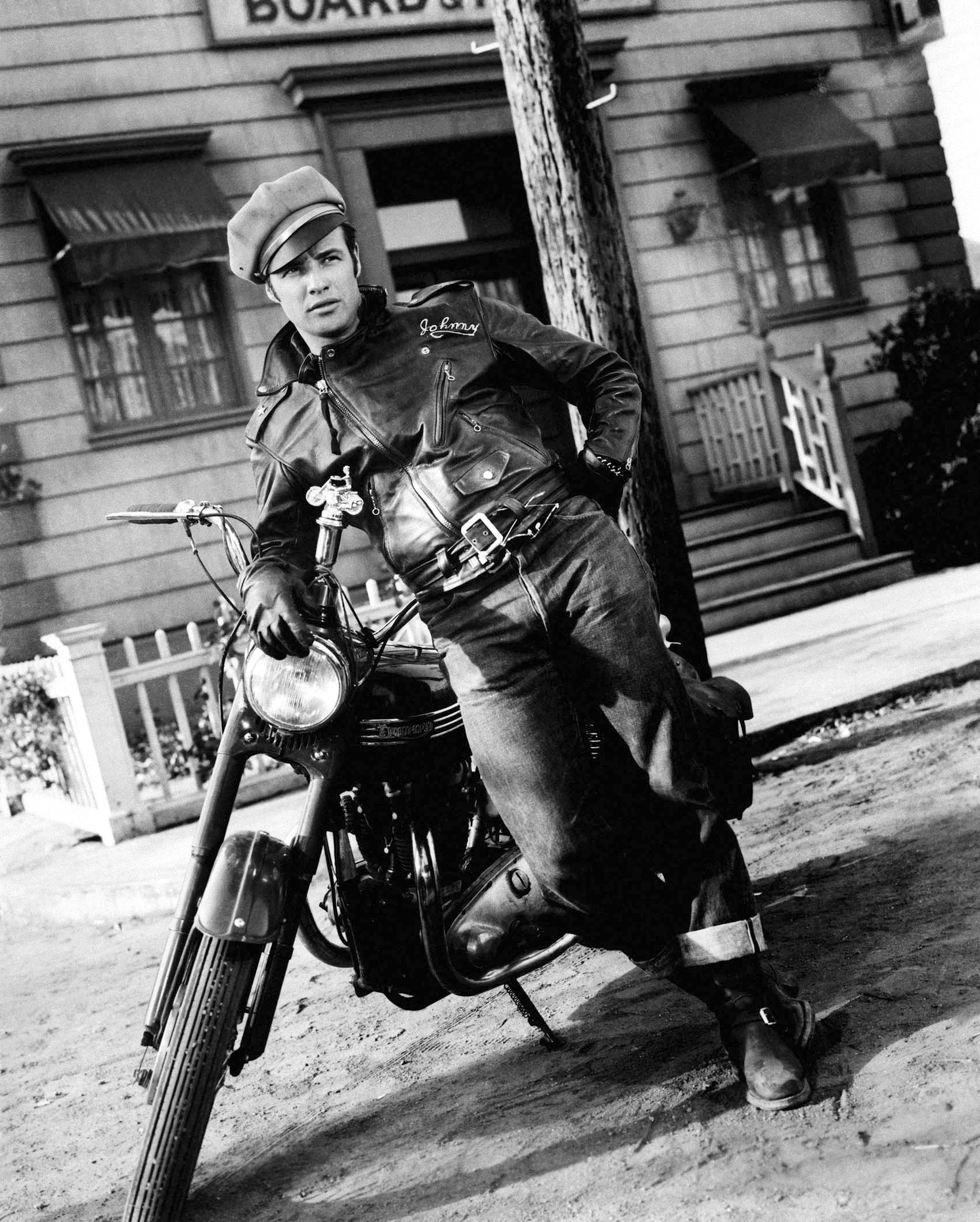 "Marlon Brando in the 1953 movie ""The Wild One"". His motorcycle is not a Harley-Davidson nor is it an Indian. His bike is a British Triumph. (Picture courtesy doctormacro.com)."