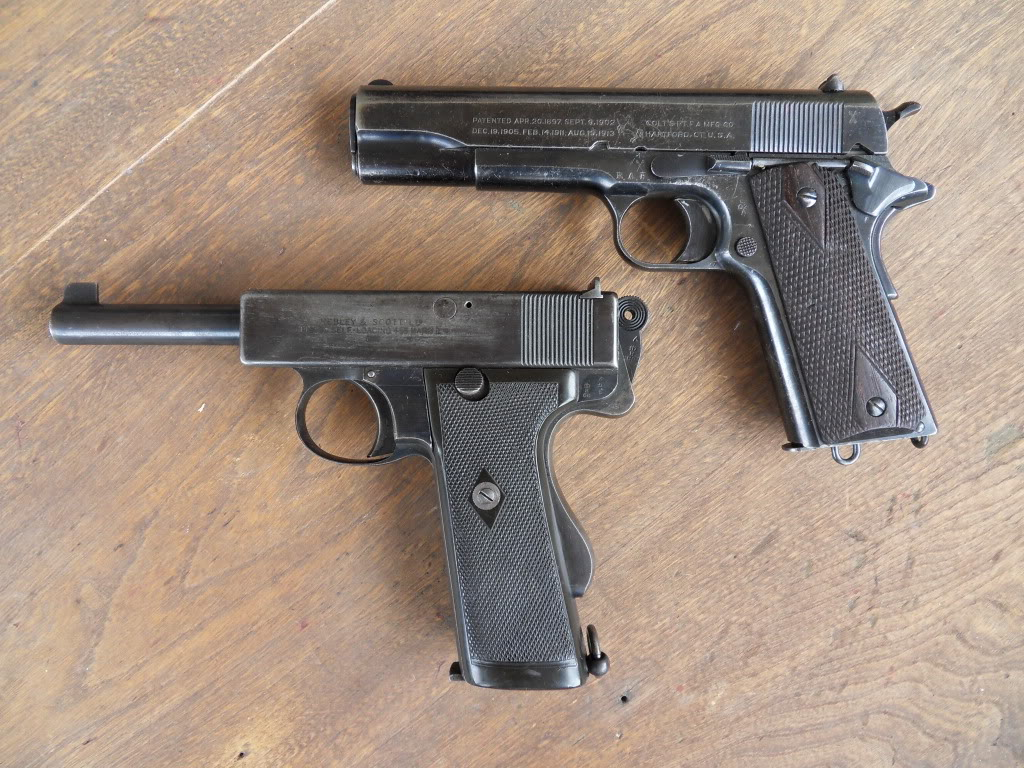 John M. Browning's M1911 (top) and William John Whiting's military model automatic pistol (bottom).
